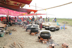 Cooks preparing food for a village feast Stock Images
