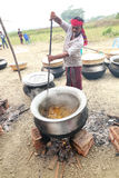 Cooks preparing food for a village feast Royalty Free Stock Photos
