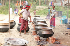Cooks preparing food for a village feast Royalty Free Stock Images