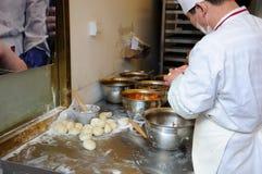 Cooks preparing Nanjing Snack royalty free stock photo