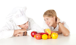 Cooks team with fruits and vegetables, Royalty Free Stock Photos
