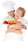 Cooks team with fruits and vegetables Stock Photo