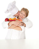 Cooks team with fruits and vegetables Stock Image