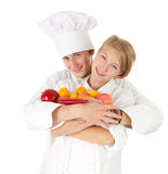 Cooks team with fruits and vegetables Stock Images