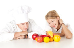 Cooks team with fruits and vegetables Royalty Free Stock Photo
