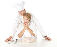 Cooks team preparing raw chicken Royalty Free Stock Photos