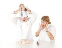 Cooks team preparing raw chicken Stock Photos