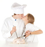 Cooks team preparing raw chicken Stock Photo