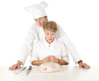 Cooks team preparing raw chicken Royalty Free Stock Image