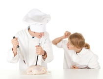Cooks team preparing raw chicken Royalty Free Stock Photo