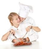 Cooks team preparing raw meat Royalty Free Stock Image