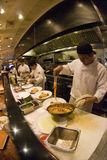 Cooks at work. Cooks prepare meals in a San Francisco restaurant stock photography