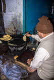 Cookshop in Varanasi. A cook shop in the small streets of the old city of Varanasi Stock Photo