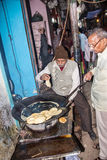 Cookshop in Varanasi. A cook shop in the small streets of the old city of Varanasi Stock Image