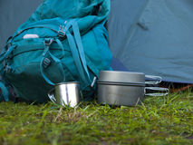 Cookware for camping is on the grass on the background of a back Stock Photography