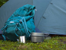 Cookware for camping is on the grass on the background of a back Royalty Free Stock Photo
