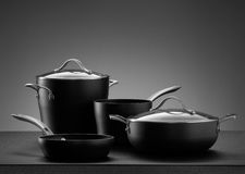 Cookware. Close up view of nice cookware set on grey color back stock photography