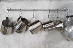 Cookware hanging. From a rack in the kitchen stock photos