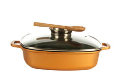 Cookware, nonstick pan and wooden spoon Stock Image