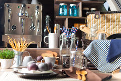 Cookware set. There's coffee jars, glass bottles, coffee mug. And picnic baskets royalty free stock images