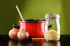 Cookware. Still life, cookware and ingredients in front of a green background royalty free stock photography