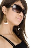 Cool 11. A cool young woman in black sunglasses on white Royalty Free Stock Photo
