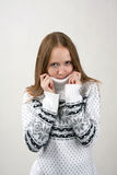 Cool!. Girl in white sweater wrap up against the cold Royalty Free Stock Photography