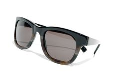 Cool 1980s style sunglasses against a white background Stock Photo