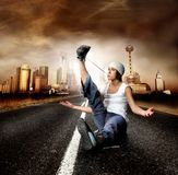 Cool. Looking dancer in acrobatic position on a citystreet royalty free stock photos