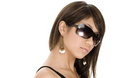 Cool 9. A cool young woman in black sunglasses on white Stock Photography
