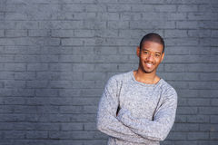 Cool african american guy smiling against gray background Stock Image
