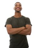 Cool african american man smiling with arms crossed Stock Photo