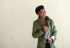 Cool african american woman smiling with green jacket Stock Photography