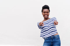 Cool african young woman pointing fingers Stock Photo