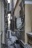 Cool!. Alleys between houses, originally designed for people to pass through are now filled with aircondioners to keep the houses cool Stock Photography