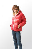 Cool Asian guy in red coat. Cool Asian guy wearing a red winter coat and sunglasses, isolated royalty free stock image
