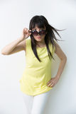 Cool Asian woman wearing bright top Stock Photo