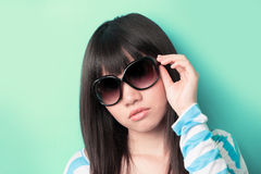 Cool Asian woman wearing sunglasses. Royalty Free Stock Photography