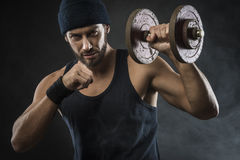 Cool attractive man lifting weights Royalty Free Stock Photography
