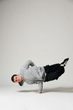 Cool b-boy standing on one hand Stock Image