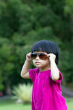 Cool baby. Portrait of little Asian baby in garden during summertime Royalty Free Stock Photos