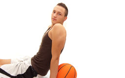 Cool basketball player resting with ball. Behind his back Royalty Free Stock Image