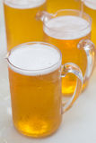 Cool beer in jug. On table Royalty Free Stock Photos