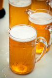 Cool beer in jug. On table Stock Images