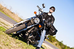 Cool bike. A man sitting on a motorcycle Royalty Free Stock Image