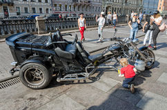 A cool bike parked on the Griboyedov canal embankment. Stock Image