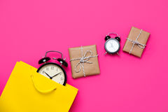 Cool black alarm clocks,  beautiful yellow shopping bag and cute Royalty Free Stock Photo