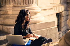Cool black girl in the city. Cool urban girl using mobile technology at the city of London Stock Photos