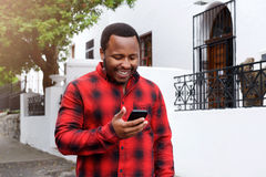 Cool black guy smiling outside with cell phone Stock Photos