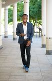 Cool black guy walking with mobile phone Royalty Free Stock Photos